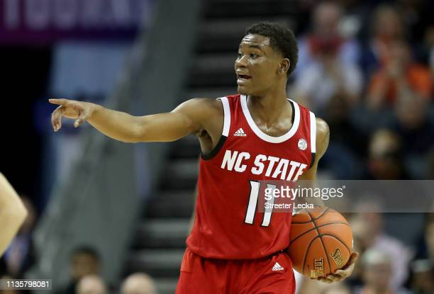 Markell Johnson of the North Carolina State Wolfpack reacts against the Virginia Cavaliers during their game in the quarterfinal round of the 2019...