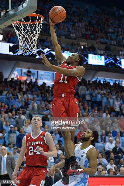 Markell Johnson of the North Carolina State Wolfpack scores over Joel Berry II of the North Carolina Tar Heels during the game at the Dean Smith...