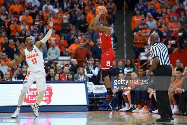 Markell Johnson of the North Carolina State Wolfpack shoots the ball against the defense of Oshae Brissett of the Syracuse Orange during the first...