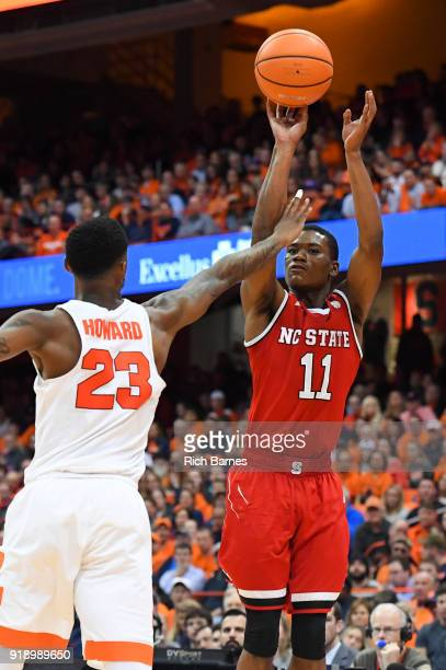 Markell Johnson of the North Carolina State Wolfpack shoots the ball against the defense of Frank Howard of the Syracuse Orange during the second...