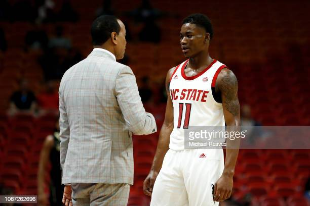 Markell Johnson of the North Carolina State Wolfpack talks with head coach Kevin Keatts against the Vanderbilt Commodores during the HoopHall Miami...