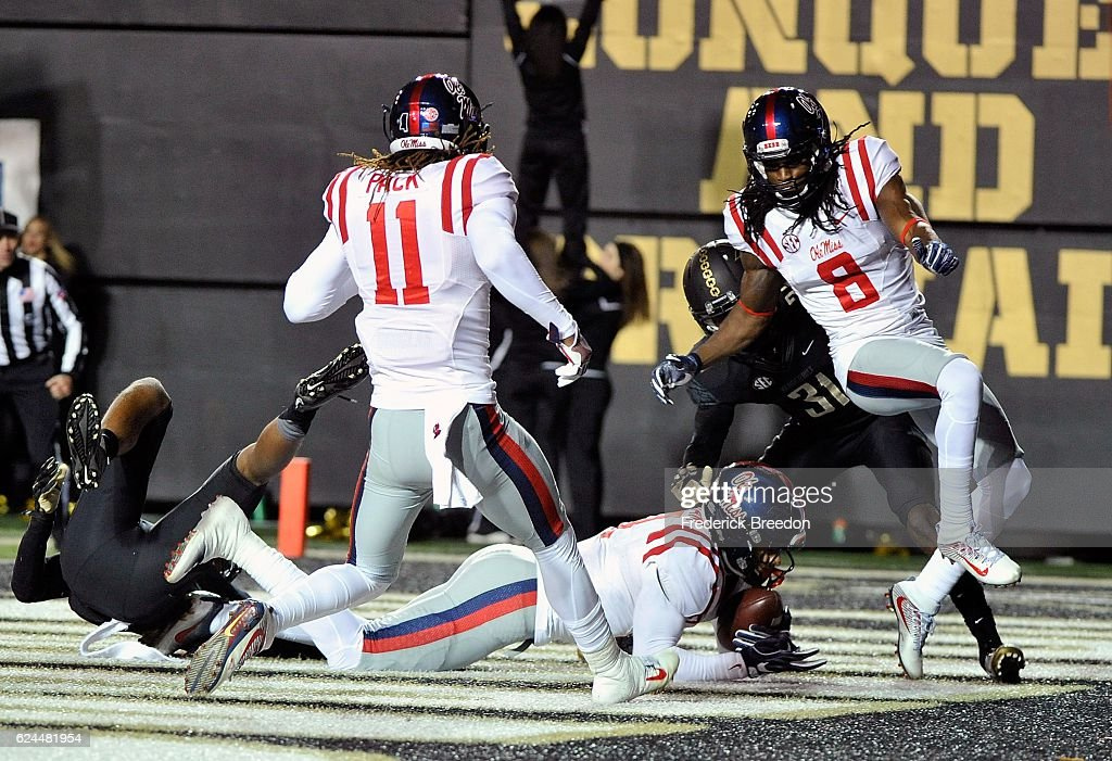 Markell Pack #11 and Quincy Adeboyejo #8 watch teammate Evan Engram #17 make a touchdown reception against the Vanderbilt Commodores during the second half at Vanderbilt Stadium on November 19, 2016 in Nashville, Tennessee.