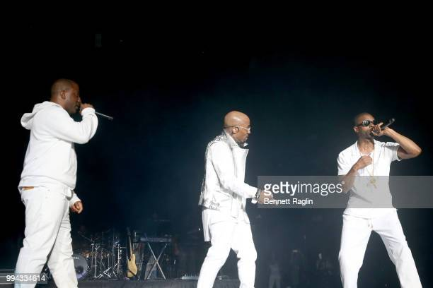Markell Riley and Agil Davidson of WreckxnEffect perform onstage with Teddy Riley during the 2018 Essence Festival presented by CocaCola Day 3 at...