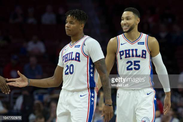 Markelle Fultz and Ben Simmons of the Philadelphia 76ers react against Melbourne United in the preseason game at Wells Fargo Center on September 28...