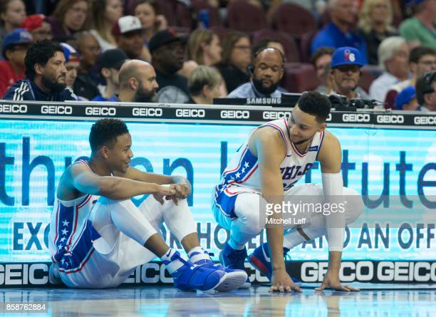 Markelle Fultz and Ben Simmons of the Philadelphia 76ers wait to come in during the preseason game against the Memphis Grizzlies at the Wells Fargo...