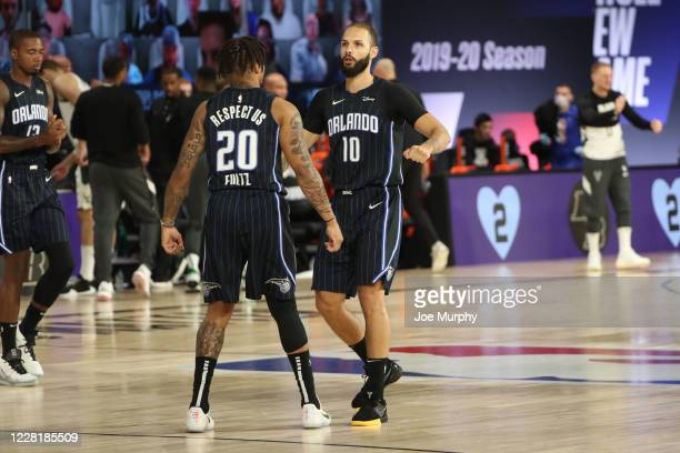 Markelle Fultz and Evan Fournier of the Orlando Magic talk during the game against the Milwaukee Bucks during Round One Game Four of the NBA Playoffs...
