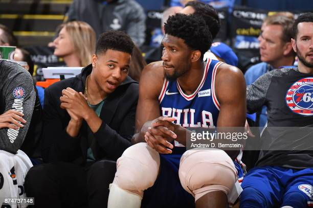 Markelle Fultz and Joel Embiid of the Philadelphia 76ers look on from the sideline during the game against the Golden State Warriors on November 11...