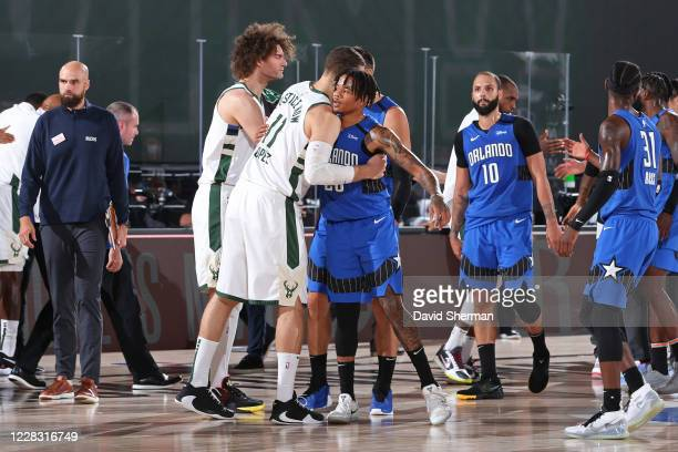 Markelle Fultz of the Orlando Magic and Brook Lopez of the Milwaukee Bucks embrace following Round One Game Five of the NBA Playoffs on August 29...
