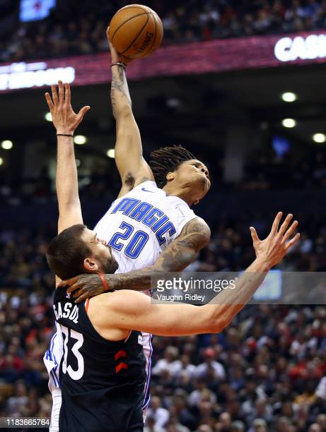 Markelle Fultz of the Orlando Magic attempts to dunk the ball as Marc Gasol of the Toronto Raptors defends during the first half of an NBA game at...