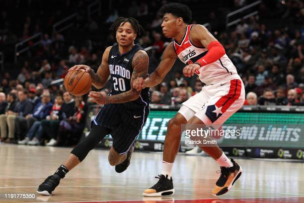 Markelle Fultz of the Orlando Magic dribbles past Rui Hachimura of the Washington Wizards during the first half at Capital One Arena on December 3...