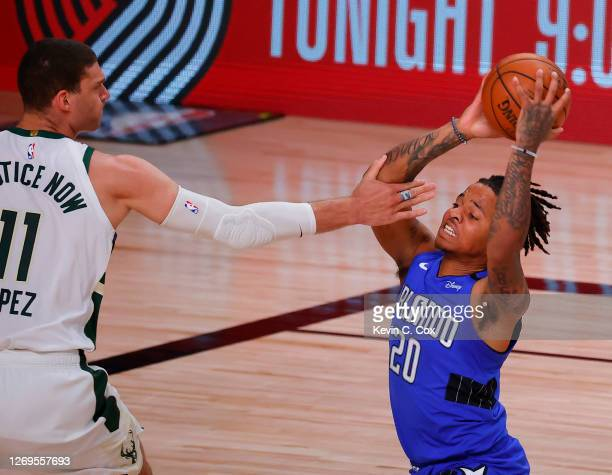 Markelle Fultz of the Orlando Magic drives against Brook Lopez of the Milwaukee Bucks during the first quarter in Game Five of the Eastern Conference...