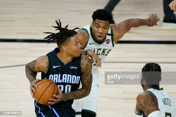 Markelle Fultz of the Orlando Magic drives against Giannis Antetokounmpo of the Milwaukee Bucks in the first half of Game Four during the first round...