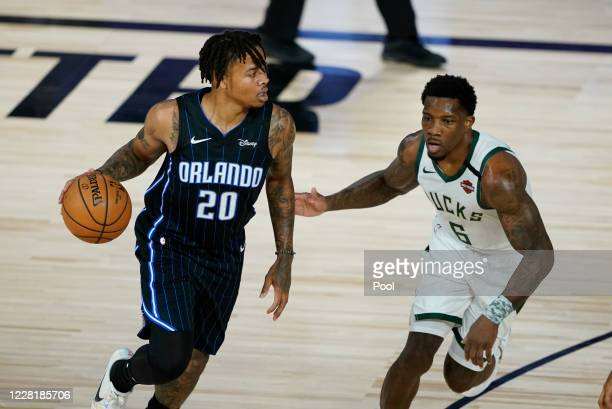 Markelle Fultz of the Orlando Magic drives past Eric Bledsoe of the Milwaukee Bucks in the first half of Game Four during the first round of the...