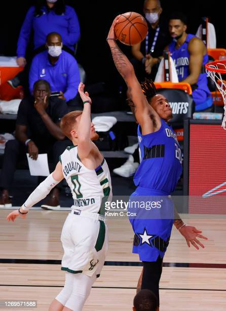 Markelle Fultz of the Orlando Magic dunks against Donte DiVincenzo of the Milwaukee Bucks during the fourth quarter in Game Five of the Eastern...