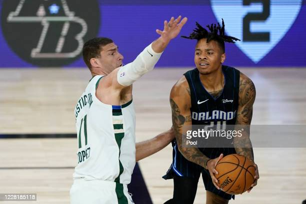 Markelle Fultz of the Orlando Magic handles the ball against Brook Lopez of the Milwaukee Bucks in the first half of Game Four during the first round...