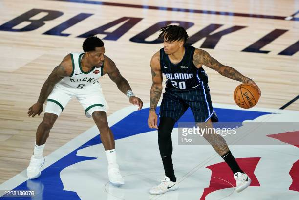 Markelle Fultz of the Orlando Magic handles the ball against Eric Bledsoe of the Milwaukee Bucks during the second half of an NBA basketball first...