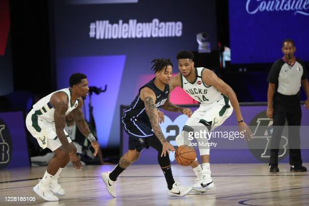 Markelle Fultz of the Orlando Magic handles the ball against the Milwaukee Bucks during Round One Game Four of the NBA Playoffs on August 24 2020 in...