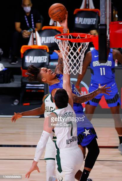 Markelle Fultz of the Orlando Magic shoots against Ersan Ilyasova of the Milwaukee Bucks during the third quarter in Game Five of the Eastern...