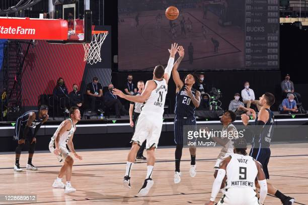 Markelle Fultz of the Orlando Magic shoots the ball while Brook Lopez of the Milwaukee Bucks plays defense during Round One Game Four of the NBA...