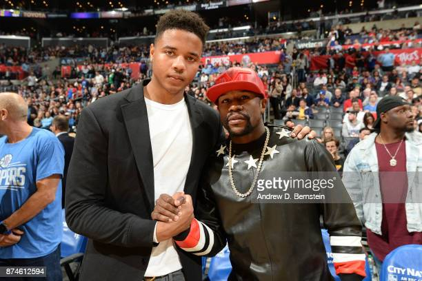 Markelle Fultz of the Philadelphia 76ers and Floyd Mayweather Jr pose for a photo after the game against the LA Clippers on November 13 2017 at...