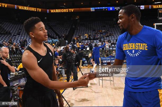 Markelle Fultz of the Philadelphia 76ers and Kevin Durant of the Golden State Warriors exchange handshakes prior to the game between the two teams on...