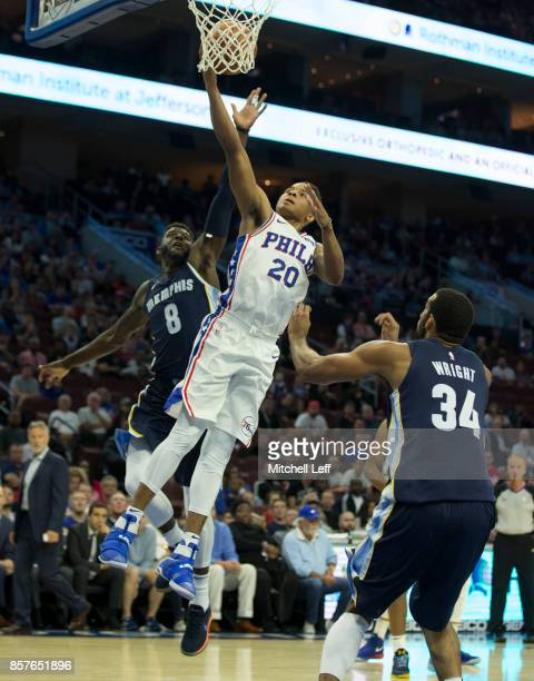 Markelle Fultz of the Philadelphia 76ers attempts a shot against James Ennis III and Brandan Wright of the Memphis Grizzlies in the first quarter of...