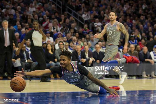 Markelle Fultz of the Philadelphia 76ers attempts to the save ball in the first quarter against the Utah Jazz at the Wells Fargo Center on November...