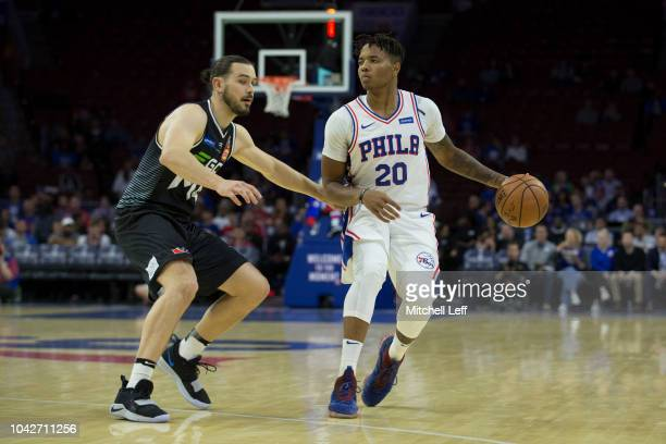 Markelle Fultz of the Philadelphia 76ers dribbles the ball against Chris Goulding of Melbourne United in the first quarter in the preseason game at...