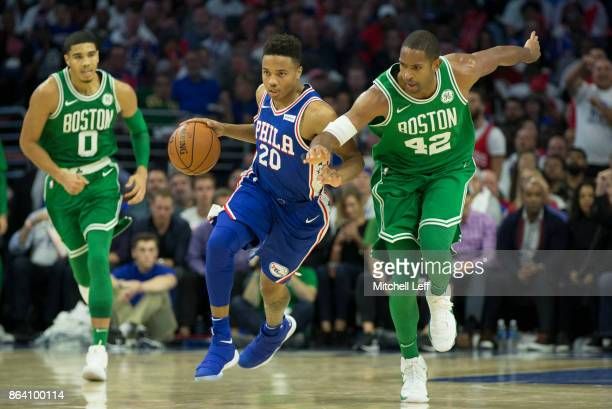 Markelle Fultz of the Philadelphia 76ers dribbles the ball against Jayson Tatum and Al Horford of the Boston Celtics in the third quarter at the...