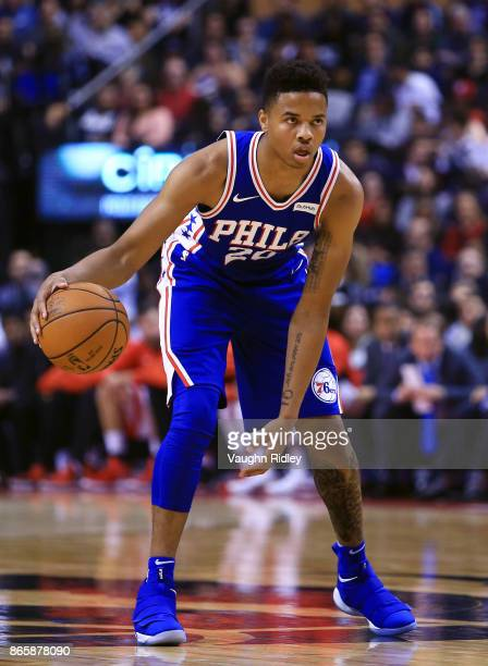 Markelle Fultz of the Philadelphia 76ers dribbles the ball during the first half of an NBA game against the Toronto Raptors at Air Canada Centre on...