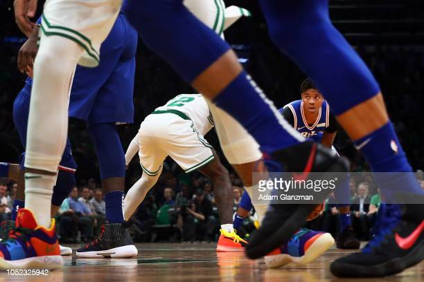 Markelle Fultz of the Philadelphia 76ers dribbles the ball while guarded by Terry Rozier of the Boston Celtics during a game at TD Garden on October...