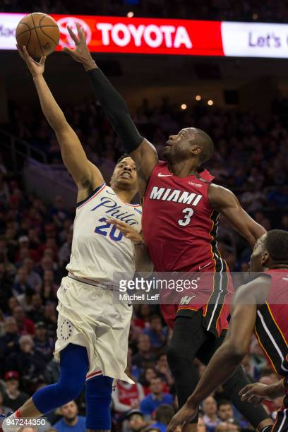 Markelle Fultz of the Philadelphia 76ers goes up for a shot against Dwyane Wade of the Miami Heat in the first quarter during Game Two of the first...