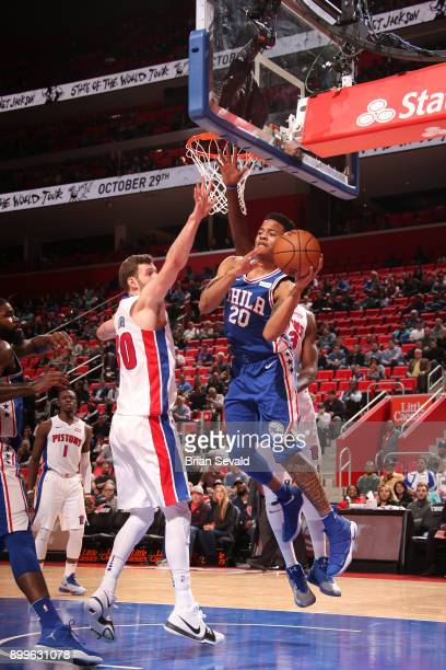 Markelle Fultz of the Philadelphia 76ers passes the ball against the Detroit Pistons on October 23 2017 at Little Caesars Arena in Detroit Michigan...