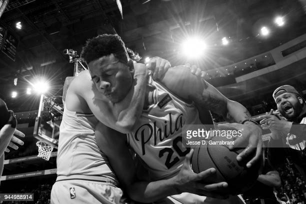 Markelle Fultz of the Philadelphia 76ers reacts after getting his first career triple double against the Milwaukee Bucks on April 11 2018 in...