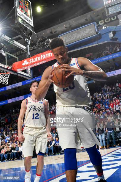 Markelle Fultz of the Philadelphia 76ers reacts after his first career triple double game against Milwaukee Bucks on April 11 2018 in Philadelphia...