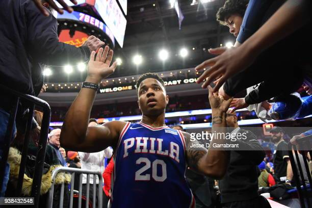 Markelle Fultz of the Philadelphia 76ers runs into the locker room while shaking fans hands against the Denver Nuggets at Wells Fargo Center on March...