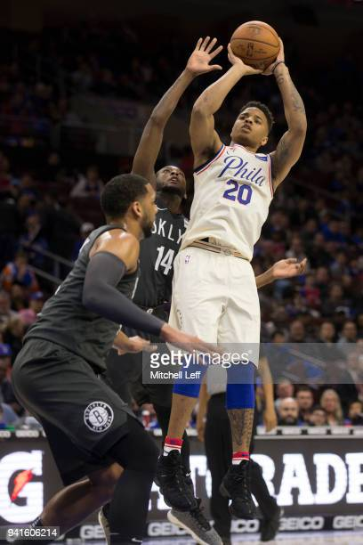 Markelle Fultz of the Philadelphia 76ers shoots the ball against Milton Doyle and Jahlil Okafor of the Brooklyn Nets in the fourth quarter at the...