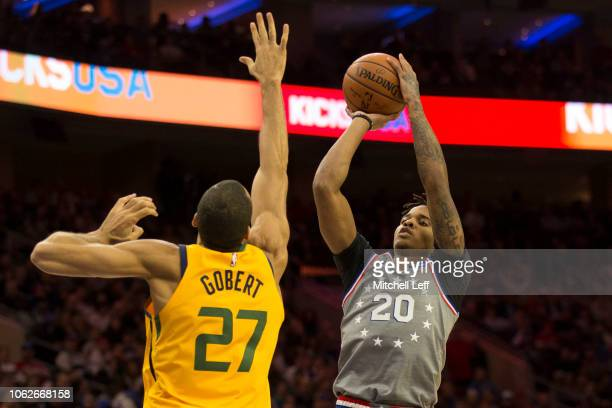 Markelle Fultz of the Philadelphia 76ers shoots the ball against Rudy Gobert of the Utah Jazz in the third quarter at the Wells Fargo Center on...