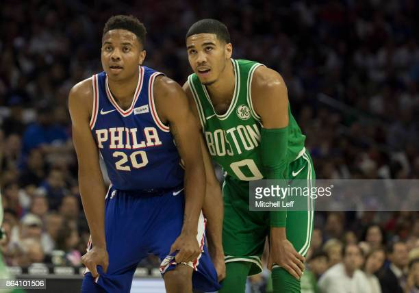 Markelle Fultz of the Philadelphia 76ers stands next to Jayson Tatum of the Boston Celtics during foul shots in the first half at the Wells Fargo...