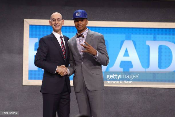 Markelle Fultz shakes hands with NBA Commissioner Adam Silver after being selected number one overall by the Philadelphia 76ers during the 2017 NBA...