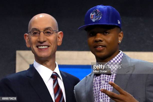 Markelle Fultz walks on stage with NBA commissioner Adam Silver after being drafted first overall by the Philadelphia 76ers during the first round of...