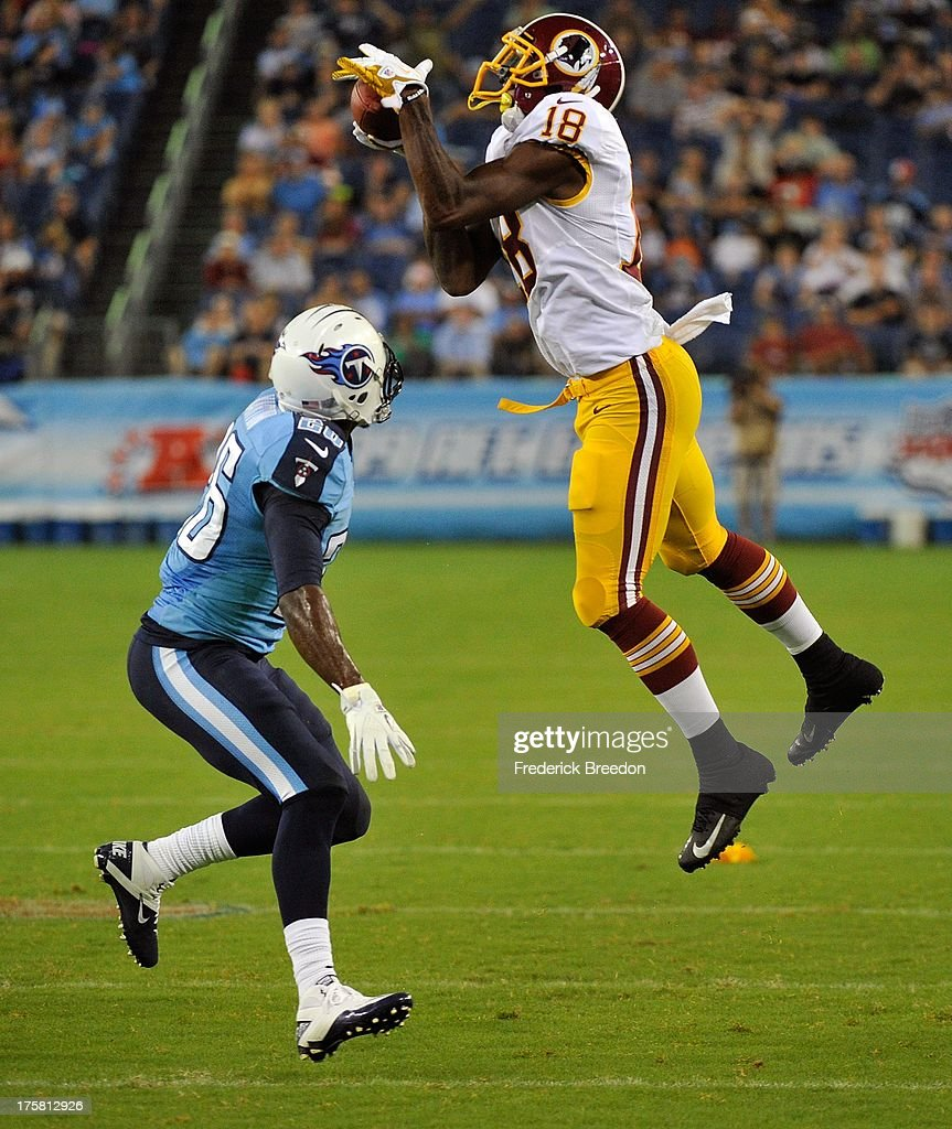 Markelle Martin #26 of the Tennessee Titans watches Lance Lewis #18 of the Washington Redskins catch a pass during a pre-season game at LP Field on August 8, 2013 in Nashville, Tennessee.