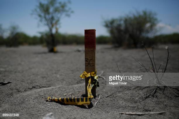 A marker point is seen where human remains were found by relatives of disappeared and organizations look for clandestine graves on June 19 2017 in...