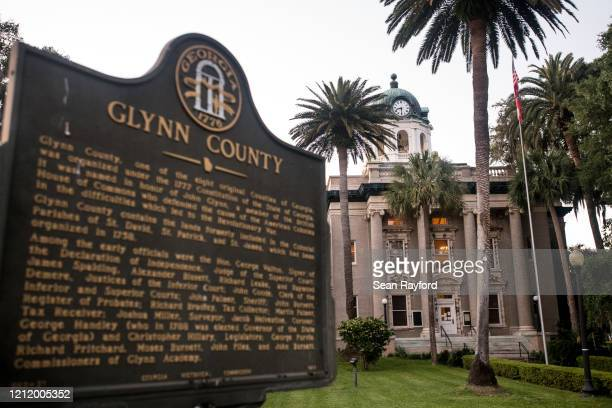 A marker stands in front of the historic Glynn County courthouse May 6 2020 in Brunswick Georgia Authorities are facing scrutiny over a recently...