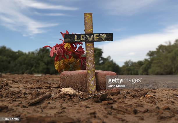 A marker stands over an immigrant's grave on September 27 2016 in Holtville California Hundreds of immigrants many who died while crossing the desert...