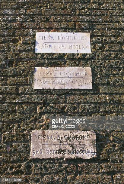 Markers with the Ombrone river's flood levels in 1961 1944 and 1864 Grosseto Tuscany Italy 19th20th century