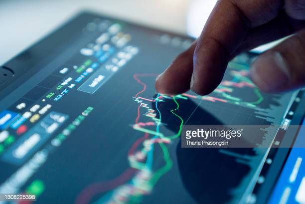 market analyze with digital monitor focus on tip of finger. - stock price stock pictures, royalty-free photos & images
