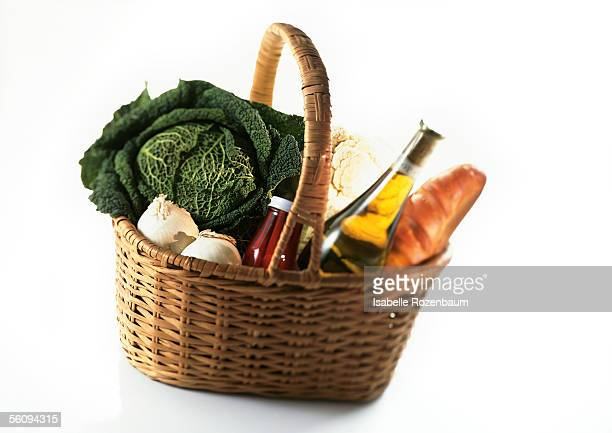 Market basket containing wine, cabbage, and loaf of bread