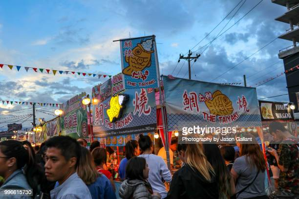 market booths in the richmond night market near vancouver, canada. - richmond british columbia stock photos and pictures