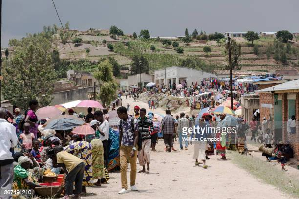 Market day in the Giko Cell of Kayumbu Sector. Rwanda is the most densely populated country in Africa. There are an estimated 352 people per square...